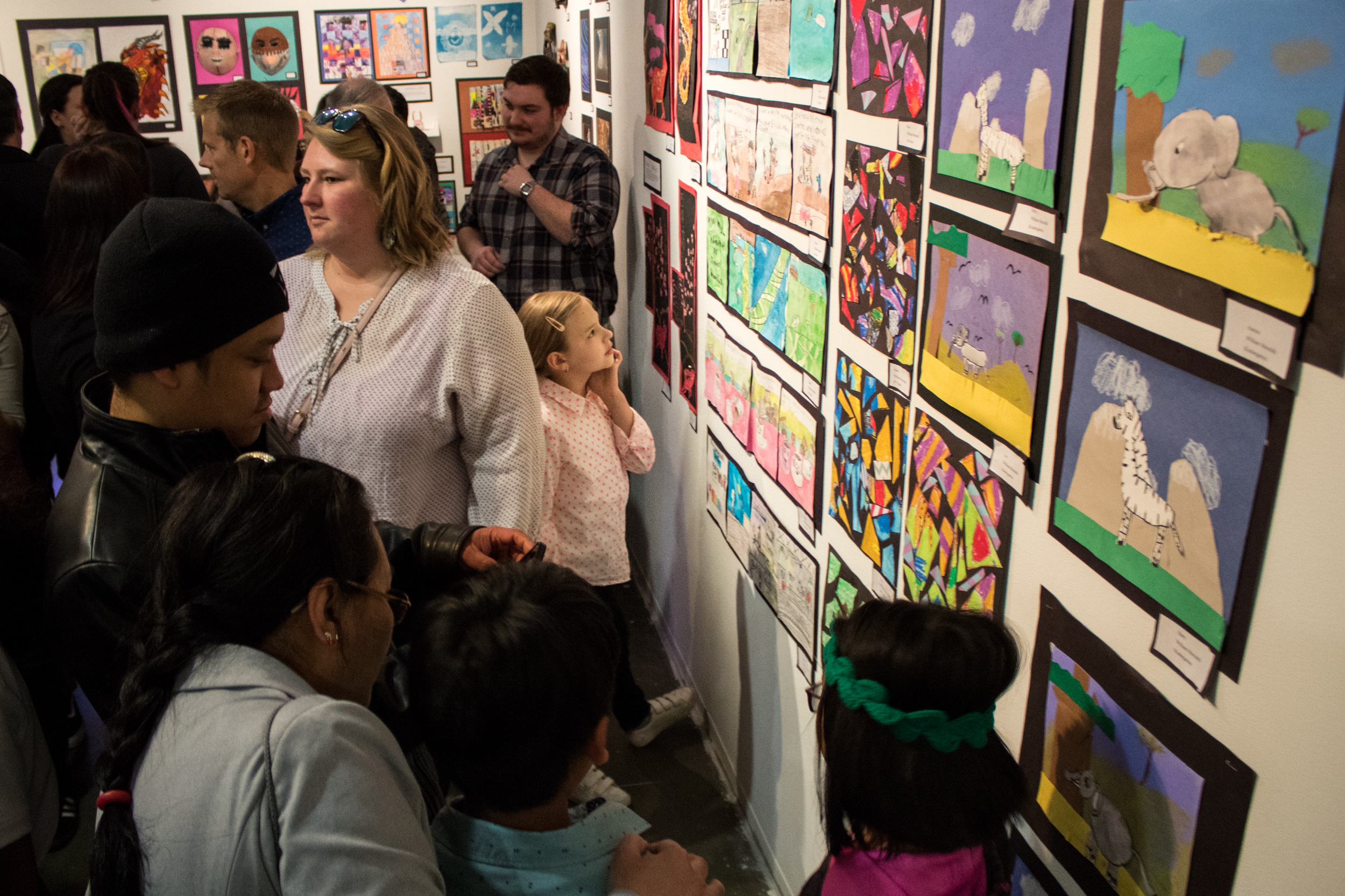 Families and students enjoy the reception for the Spring 2019 Art of Student Teaching Exhibition