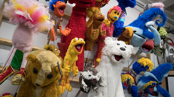 Puppets hanging on the wall at Monkey Boys Productions.