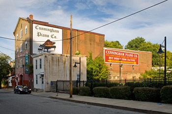 Signage advertising Cunningham Piano Co.