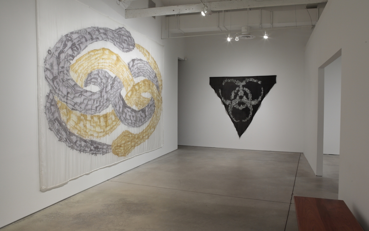 Installation photograph of Emily Erb's silk paintings