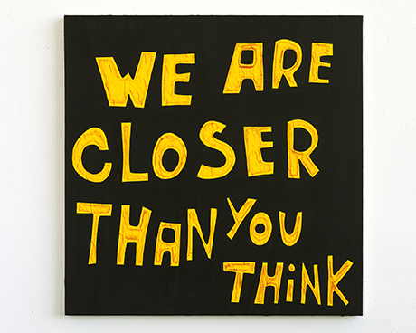 "Painting that reads ""we are closer than you think."""