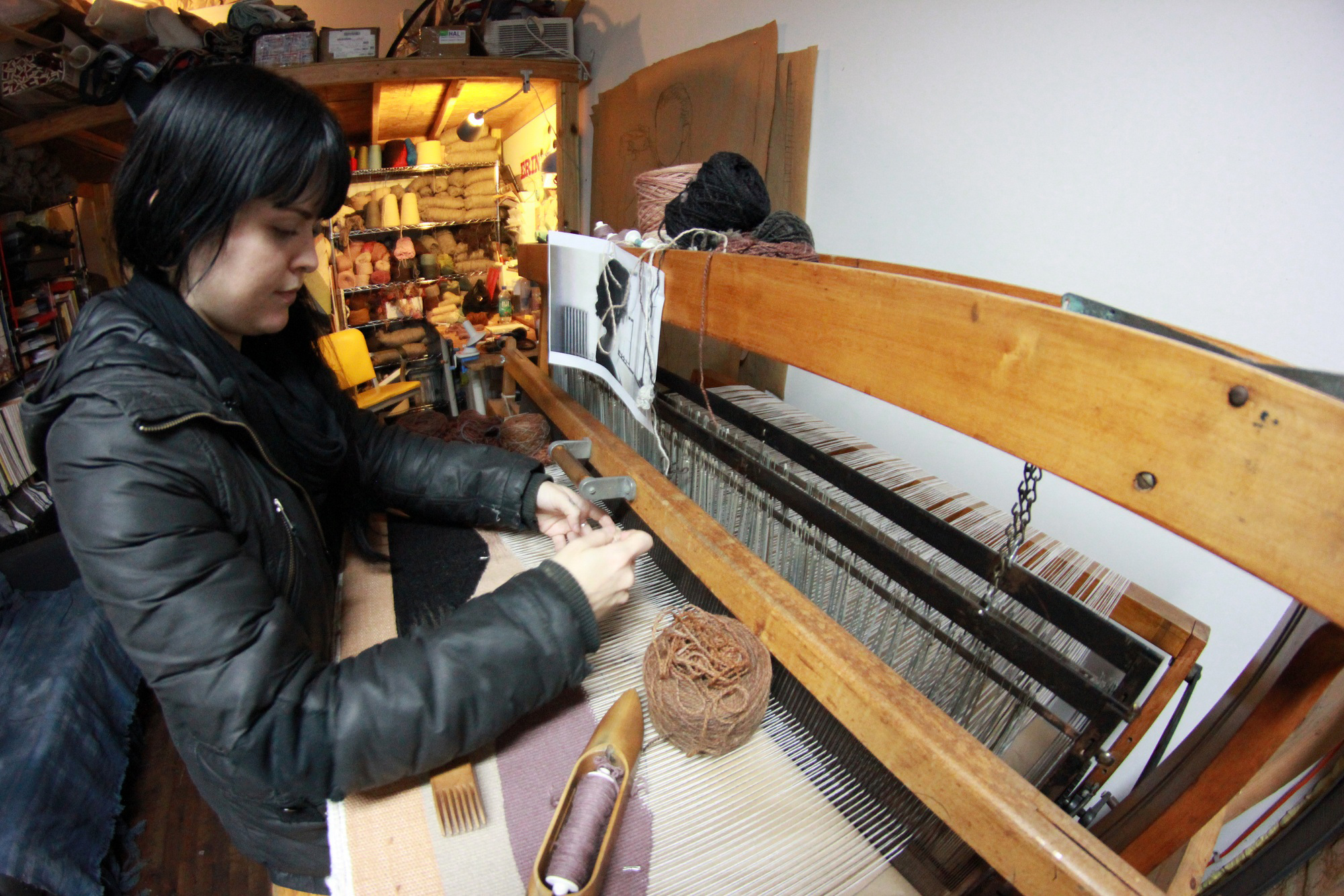 erin working at loom