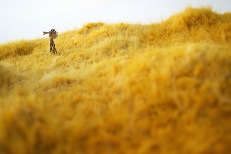 Image of a windmill in a field of golden fake fur