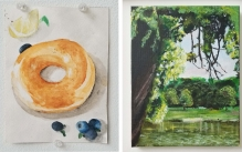 Two paintings - a watercolor painting of a bagel with a lemon wedge and blue berries, and an acrylic painting of a lake landscape.