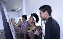 Art Start students looking at each other's work