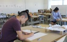 Student working on an architectural model.
