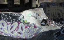 Student sketching inside a skateboarding bowl at FDR park in Philadelphia