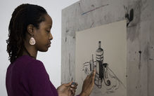 Adult student drawing a still life on a drawing board
