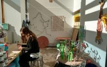 MFA student working in her ceramics studio