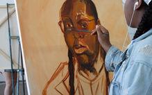 Student paints a portrait