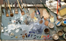 Colorful oil painting palette with many brushes.