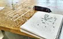 an architectural sketch and wood model