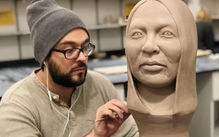 Photograph of the instructor carving a full-sized bust out of clay.