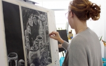 a student drawing a still-life