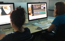 Students editing videos on the Tyler computers
