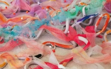 Detail image of a sculpture made of colorfully painted tulle and ceramic coils.