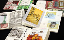 Collection of open sketchbooks showing colored pencil drawings.