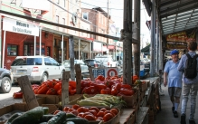 Color photograph of produce stands in the Philadelphia Italian Market.