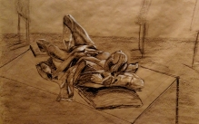 Charcoal drawing of a male reclining model.