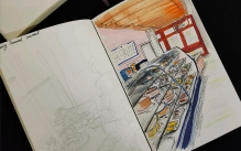 Colorful drawing of a stand at the Reading Terminal Market inside a sketchbook.
