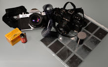Photograph of a still-life of film photography related items.