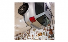 Car hanging from ceiling