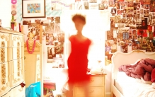Fine art photography depicting a blurry figure in a cluttered bedroom.