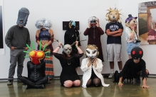 Group of students wearing handmade masks and costumes.