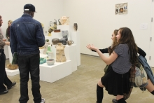 Sudents interact with Clay Show installation