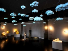 """Simulated Weather"" by Colby Parsons fills the room with clouds."