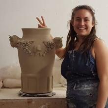 Natalie Kuenzi with a Roberto Lugo pot in progress.