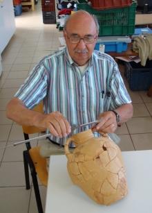 philip betancourt measures a ceramic jug