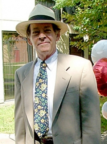 Dr. Cohen profile photo wearing a suit and floral hat