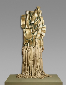 Malcolm X #3 stele by Chase-Riboud, Polished bronze, rayon, and cotton