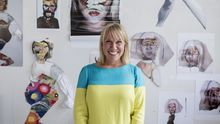 Delaney smiling in front of her work