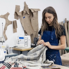 Paige working at the fabric workshop