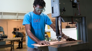 student working in sculpture woodshop