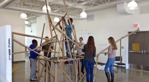 High school students working to build a structure out of cardboard and duct tape.