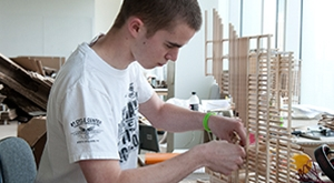 Architecture student constructing a model