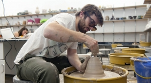 Ceramic student working in studio