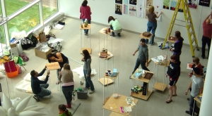 Students setting up an exhibit