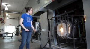 Student working in glass studio