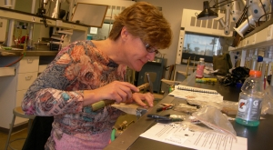 Adult student working on a jewelry project in the Tyler metals studio.