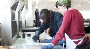 People working in printmaking studio