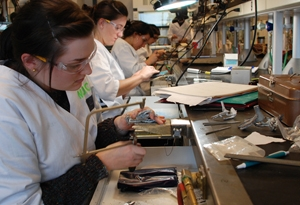female students working with jewelry tools