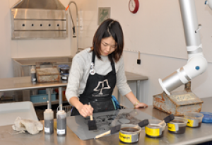 student works on printmaking project