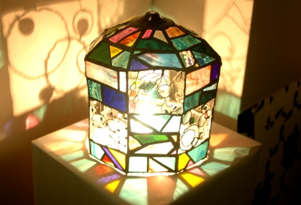 stained glass sculpture shining light