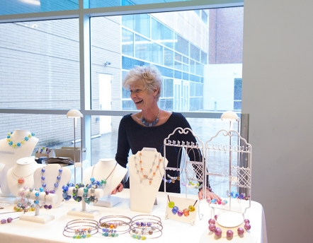Glass alumna with her work