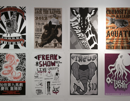 series of posters hanging in gallery