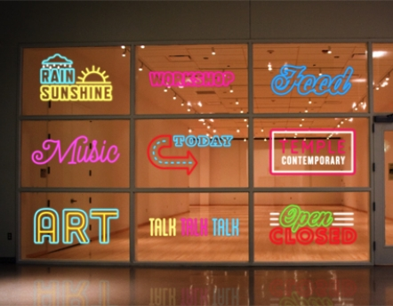 neon signs in front of gallery